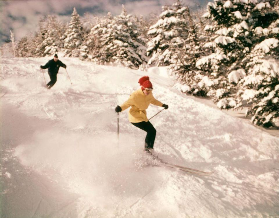 <p>A man and woman ski down a slope with fresh powder. The only difference between now and then? The over-the-top fashion of the '70s.</p>