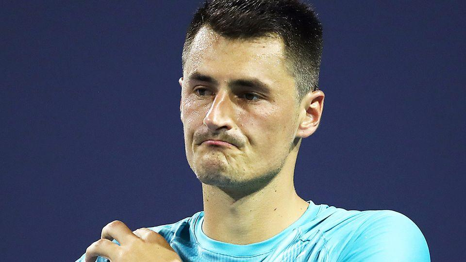 Bernard Tomic is seen here cutting a frustrated figure during a tennis match.