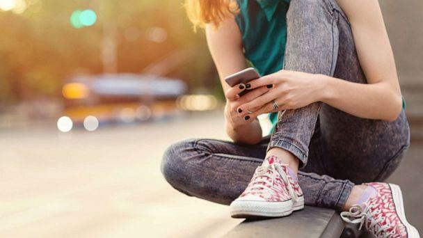 PHOTO: A teen girl uses her phone outdoors in an undated stock photo. (STOCK PHOTO/Getty Images)