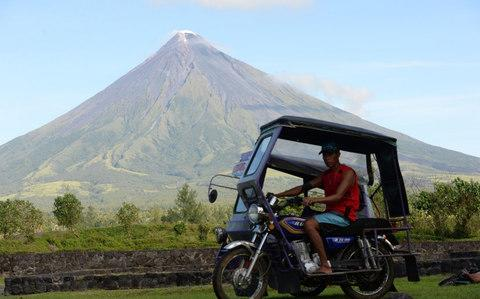 An archive photo of the Mayon volcano when not at risk of eruption - Credit: AFP