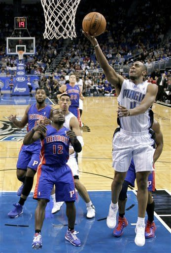 Orlando Magic's Arron Afflalo, right, gets in a shot in front of Detroit Pistons' Will Bynum (12) during the first half of an NBA basketball game, Wednesday, Nov. 21, 2012, in Orlando, Fla. (AP Photo/John Raoux)
