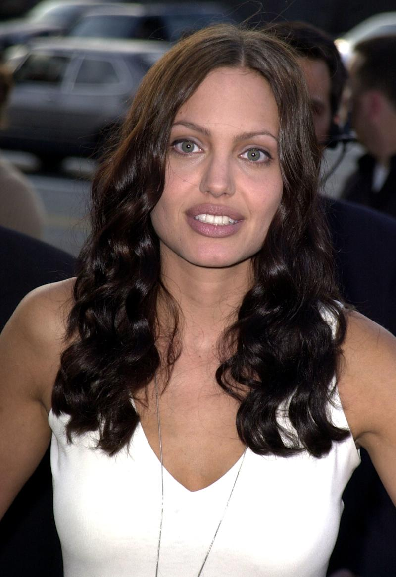 A bit of self tanner, and some soft curls were the first steps towards a grown-up look. Angelina Jolie at the premiere of Original Sin in Los Angeles, California, July 2001. Photo by Getty Images.