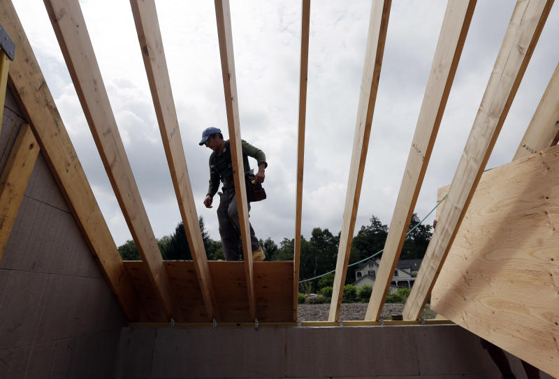In this Tuesday, July 9, 2013, photo, a worker installs a roof on a zero net energy home on Tuesday, July 9, 2013, in New Paltz, N.Y. The National Association of Home Builders reports on its index of confidence among U.S. homebuilders for July on Tuesday, July 16, 2013. (AP Photo/Mike Groll)
