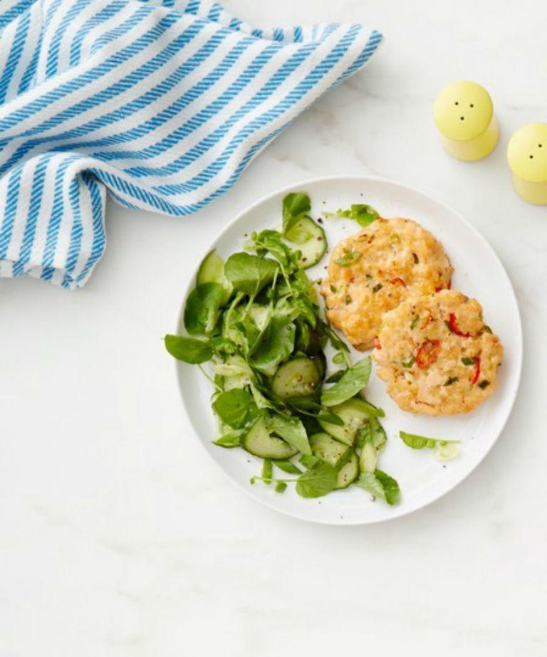 """<p>Smoky salmon patties get a zesty kick from the spicy cucumber salad.</p><p><em><a href=""""https://www.womansday.com/food-recipes/food-drinks/recipes/a53319/salmon-cakes-and-cucumber-salad/"""" rel=""""nofollow noopener"""" target=""""_blank"""" data-ylk=""""slk:Get the Salmon Cakes and Cucumber Salad recipe."""" class=""""link rapid-noclick-resp"""">Get the Salmon Cakes and Cucumber Salad recipe.</a></em></p>"""