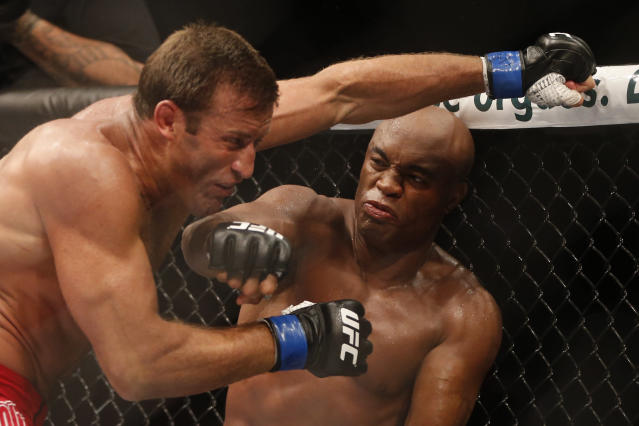 Anderson Silva, from Brazil, right, fights Stephan Bonnar, from the United States, during their light heavyweight mixed martial arts bout at UFC 153 in Rio de Janeiro, early Sunday, Oct. 14, 2012. Silva defeated Bonnar. (AP Photo/Felipe Dana)