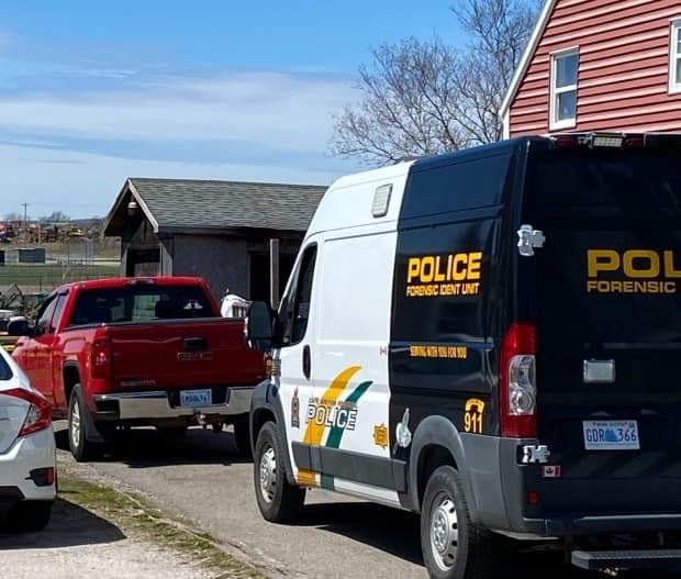 Police are investigating after a body was discovered inside a burning shed at this Sydney Mines property.  (CBC News - image credit)