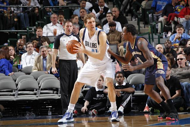 DALLAS, TX - FEBRUARY 26: Dirk Nowitzki #41 of the Dallas Mavericks controls the ball against Al-Farouq Aminu #0 of the New Orleans Pelicans on February 26, 2014 at the American Airlines Center in Dallas, Texas. (Photo by Glenn James/NBAE via Getty Images)