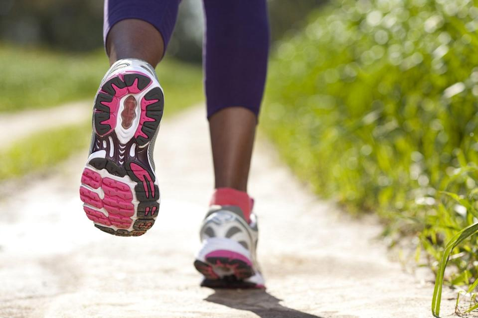 Close-up of women's sport shoes running outdoors