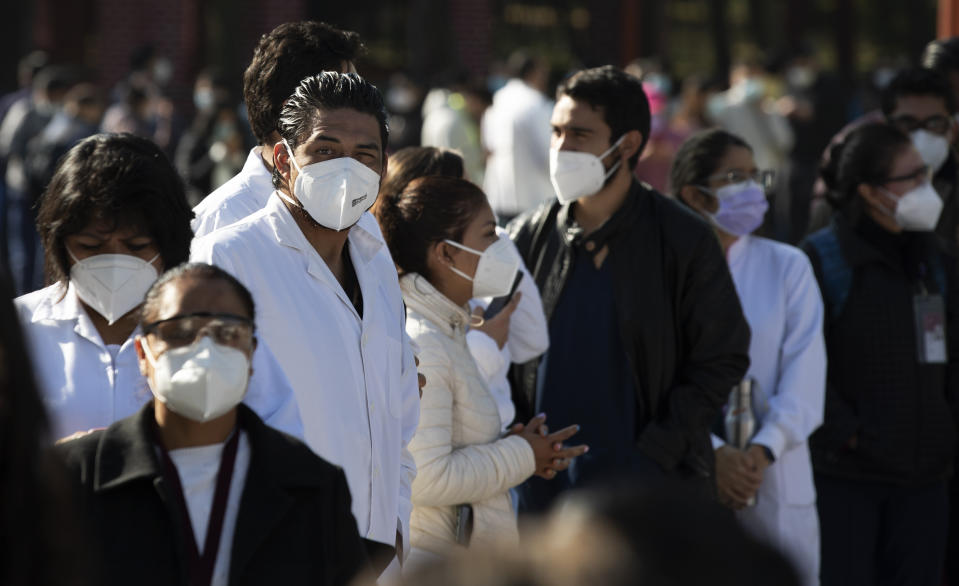 Health workers and soldiers wait to be given the Pfizer-BioNTech vaccine for COVID-19 at the N-1 military base in Mexico City, Wednesday, Dec. 30, 2020. (AP Photo/Marco Ugarte)