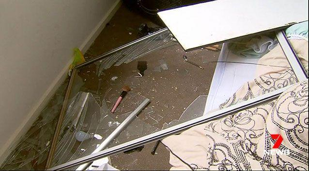 Windows were broken, walls were damaged, and furniture and items strewn across the house. Source: 7 News