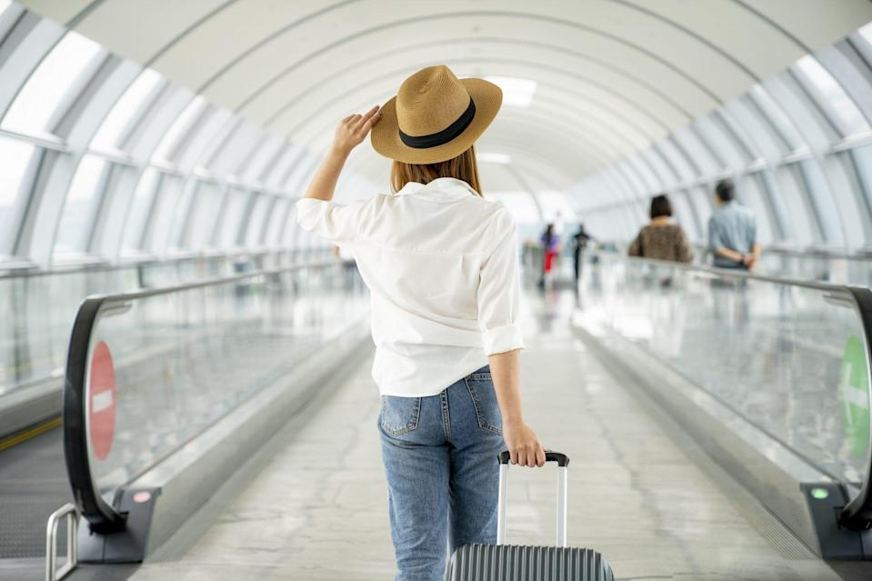 woman traveling alone waling in airport