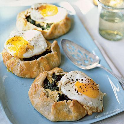 """<p>You can make these ahead, without the fried egg on top. Reheat in the oven; then, fry eggs and place on top of each <a href=""""https://www.myrecipes.com/how-to/how-to-make-a-galette"""" rel=""""nofollow noopener"""" target=""""_blank"""" data-ylk=""""slk:galette"""" class=""""link rapid-noclick-resp"""">galette</a> just before serving.</p>"""