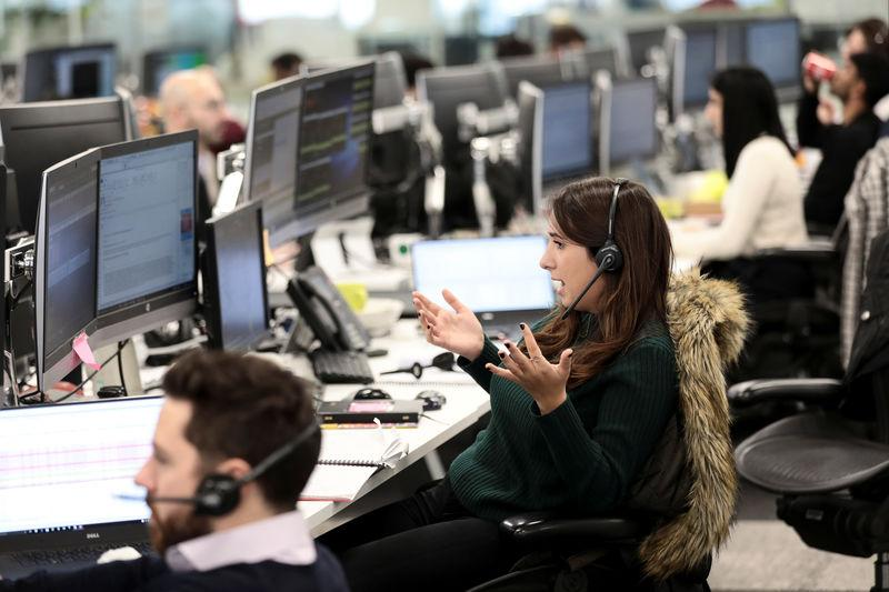 FILE PHOTO: A broker reacts on the IG Index the trading floor