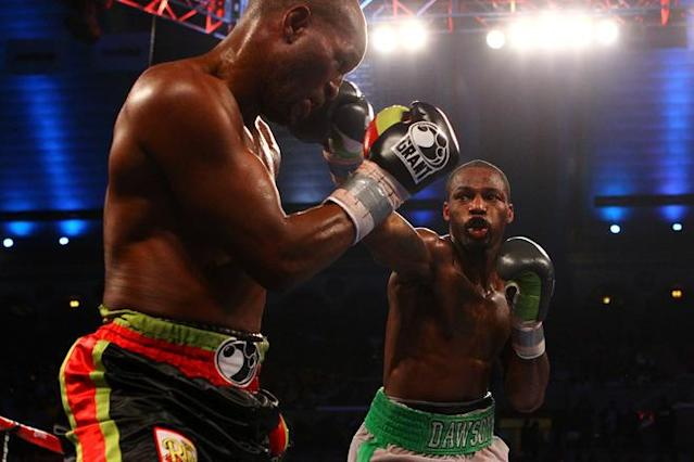 ATLANTIC CITY, NJ - APRIL 28: Chad Dawson (grey and green trunks) lands a punch against Bernard Hopkins (black trunks) during their WBC & Ring Magazine Light Heavyweight Title fight at Boardwalk Hall Arena on April 28, 2012 in Atlantic City, New Jersey. (Photo by Al Bello/Getty Images)