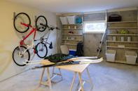 "<p>If you do one single thing when organizing your garage, it should be to get everything off the floor by whatever means possible. Not only does this make things easier to access when you need them, but it protects items should there be leaks or minor flooding. </p><p>As Stacy Schweiger of <a href=""https://www.sunshineorganizing.biz/"" rel=""nofollow noopener"" target=""_blank"" data-ylk=""slk:Sunshine Organizing"" class=""link rapid-noclick-resp"">Sunshine Organizing</a> says, ""The bottom line when it comes to garage organization? It's all about the floor space. Utilize all existing closets, cabinetry and shelving to conceal garage items and elevate most everything else from the floor. Use wall hooks, plastic bins on wall shelves, and an overhead storage system if needed to optimize clear floor space in the garage.""</p>"