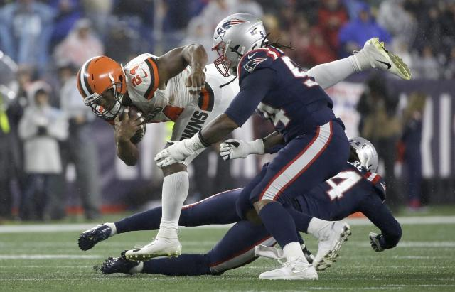 Cleveland Browns running back Nick Chubb, left, tries to elude New England Patriots linebacker Dont'a Hightower, foreground, and cornerback Stephon Gilmore, right rear, in the second half of an NFL football game, Sunday, Oct. 27, 2019, in Foxborough, Mass. (AP Photo/Steven Senne)