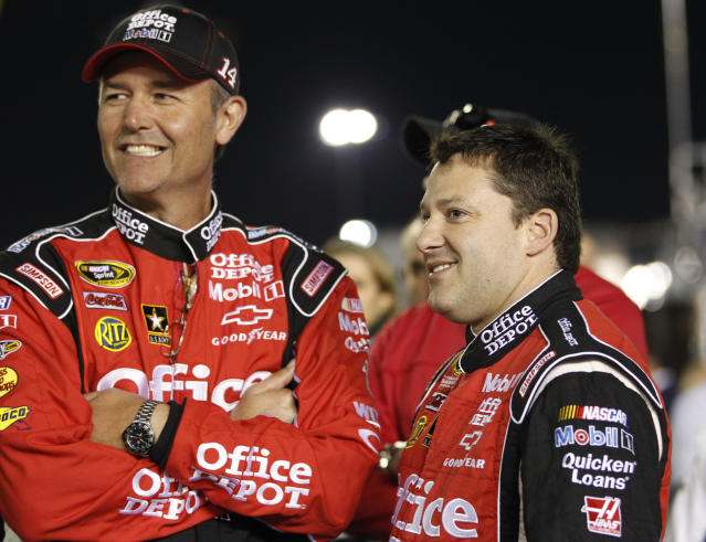 Tony Stewart, right, talks with crew chief Steve Addington before the NASCAR Daytona 500 auto race at Daytona International Speedway in Daytona Beach, Fla., Monday, Feb. 27, 2012. (AP Photo/Terry Renna)