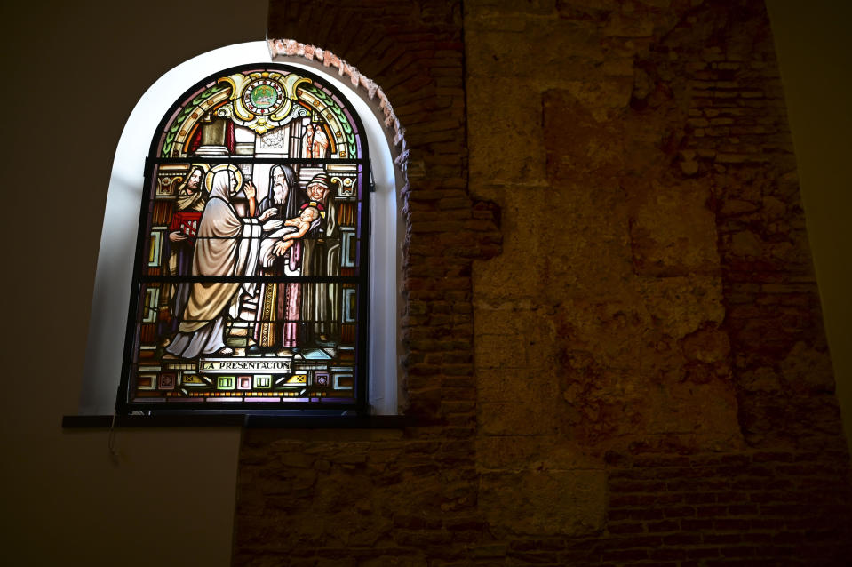 A stained glass window stands inside the San Jose Church, the second oldest Spanish church in the Americas, that will reopen following a massive reconstruction that took nearly two decades to complete in San Juan, Puerto Rico, Tuesday, March 9, 2021. It was a project many in Puerto Rico thought would fail given the never-ending funding problems. (AP Photo/Carlos Giusti)