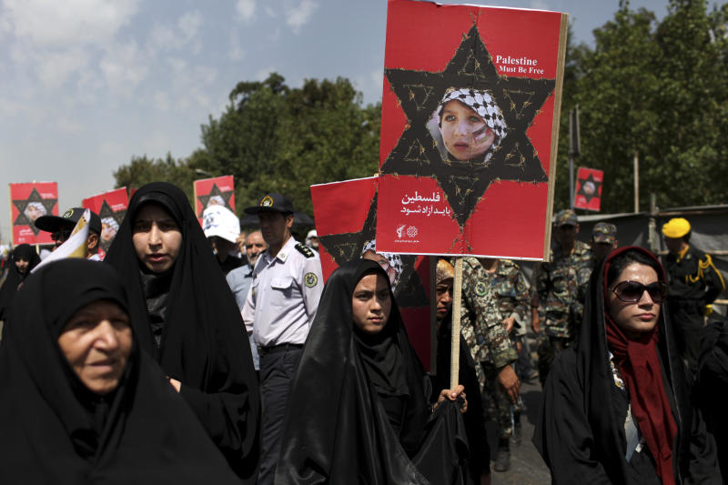 Iranian women attend an annual pro-Palestinian rally marking Al-Quds (Jerusalem) Day in Tehran, Iran, Friday, Aug. 2, 2013. The last Friday of the Islamic holy month of Ramadan is observed in many Muslim countries as Al-Quds day, as a way of expressing support to the Palestinians and emphasizing the importance of Jerusalem to Muslims. (AP Photo/Ebrahim Noroozi)