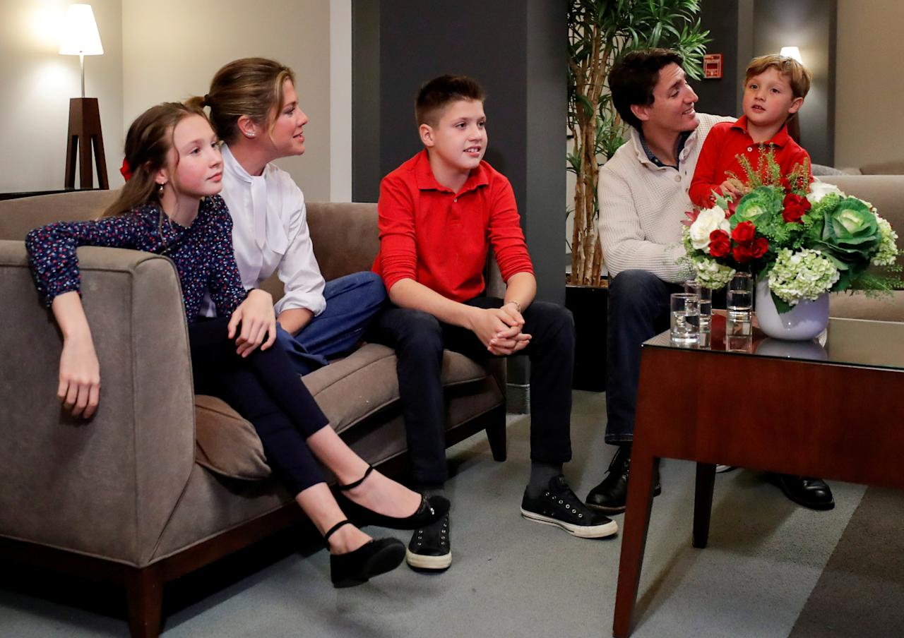 Liberal leader and Canadian Prime Minister Justin Trudeau and his wife Sophie Gregoire Trudeau, sons Xavier and Hadrien, and daughter Ella-Grace watch a television broadcast of the initial results from the federal election, in Montreal, Canada, October 21, 2019. REUTERS/Stephane Mahe     TPX IMAGES OF THE DAY