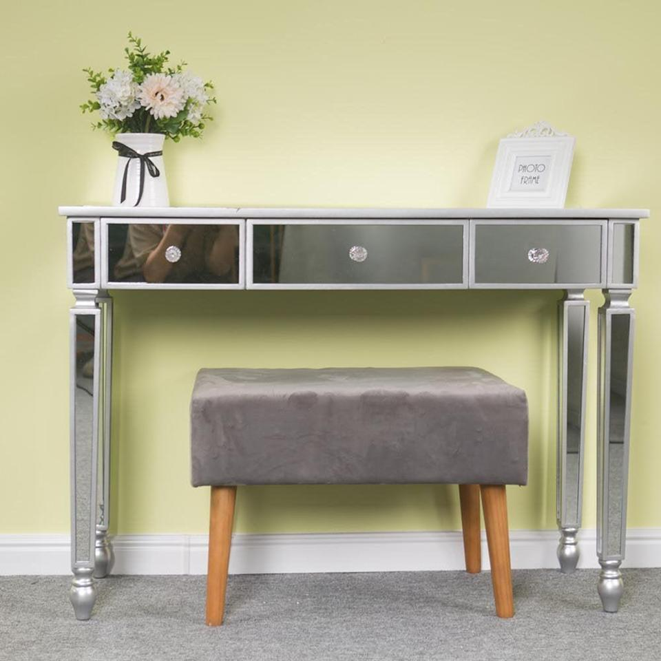 <p>If you have a glam aesthetic, you can't go wrong with this <span>Ktaxon Mirrored Console Table Sofa Vanity Table with 3 Drawers Entryway Table with Storage</span> ($170, originally $300).</p>