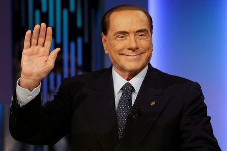 """FILE PHOTO: Italy's former Prime Minister Silvio Berlusconi waves before the taping of the television talk show """"8 e mezzo"""" (8 and half) in Rome, Italy February 21, 2018. REUTERS/Max Rossi/File Photo"""