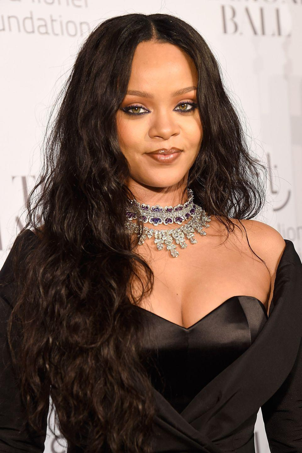<p>Here, Rihanna debuts jet black hair and wears her hair long and wavy.</p>