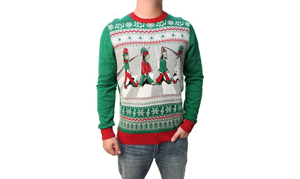 """<p>The Beatles + elves + Abbey Road come together — pun intended — for this ugly Christmas sweater celebration of one of the greatest bands ever. <strong><a rel=""""nofollow noopener"""" href=""""https://holidaycrush.com/collections/knitted-sweaters/products/beatles-abbey-road-christmas-sweater?variant=54302703635"""" target=""""_blank"""" data-ylk=""""slk:Buy here"""" class=""""link rapid-noclick-resp"""">Buy here</a></strong> </p>"""