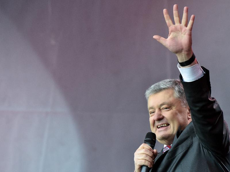 President Petro Poroshenkomade closer ties with the West and cutting ties with the country's Soviet pastthe central mission of histerm (AFP Photo/Sergei SUPINSKY)