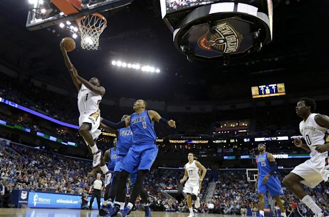 New Orleans Pelicans point guard Tyreke Evans (1) drives to the basket in front of Dallas Mavericks small forward Shawn Marion (0) in the first half of an NBA basketball game in New Orleans, Wednesday, Dec. 4, 2013. (AP Photo/Gerald Herbert)