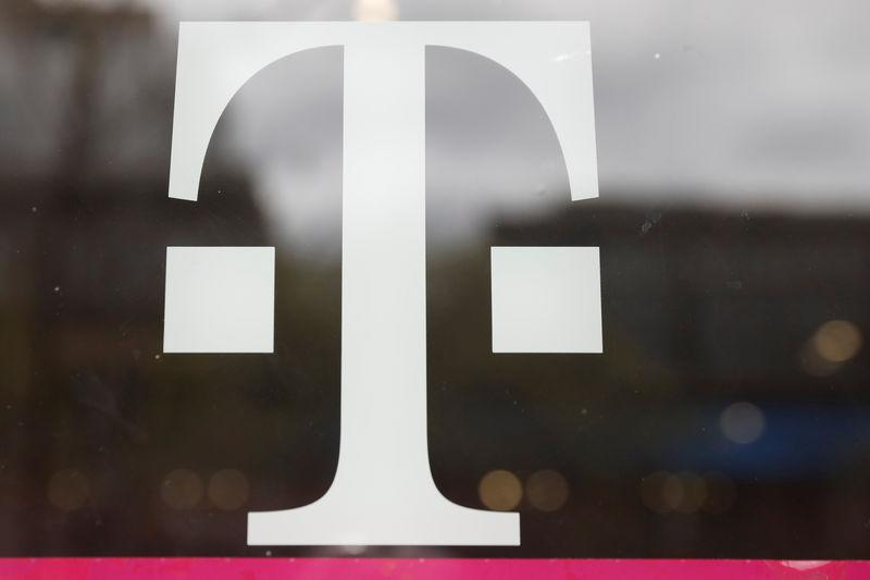 A T-Mobile logo is seen on the storefront door of a store in Manhattan, New York, U.S., April 30, 2018. REUTERS/Shannon Stapleton
