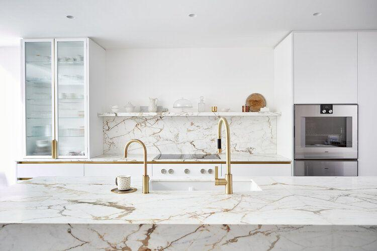 """<p>Marble is the classic choice for a white kitchen, adding texture and warmth that breaks up a pure white palette. Solid blocks of marble across kitchen countertops, splashbacks, and shelving is as luxurious as it is impactful, especially with matte brass finishes. </p><p>Pictured: <a href=""""https://www.blakeslondon.com/west-london/"""" rel=""""nofollow noopener"""" target=""""_blank"""" data-ylk=""""slk:Kitchen by Blakes London"""" class=""""link rapid-noclick-resp"""">Kitchen by Blakes London</a></p>"""