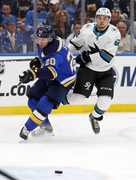 St. Louis Blues left wing Alexander Steen (20) and San Jose Sharks right wing Kevin Labanc (62) chase the puck during the third period in Game 4 of the NHL hockey Stanley Cup Western Conference final series Friday, May 17, 2019, in St. Louis. The Blues won 2-1 to even the series 2-2. (AP Photo/Jeff Roberson)