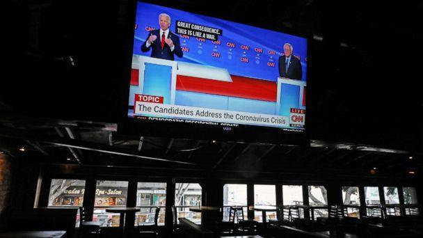 PHOTO: Democratic presidential candidate former Vice President Joe Biden (L) and Democratic presidential candidate Sen. Bernie Sanders (I-VT) speak about the coronavirus crisis on a live broadcast during the 11th Democratic Party 2020 presidential debate. (Mario Tama/Getty Images)