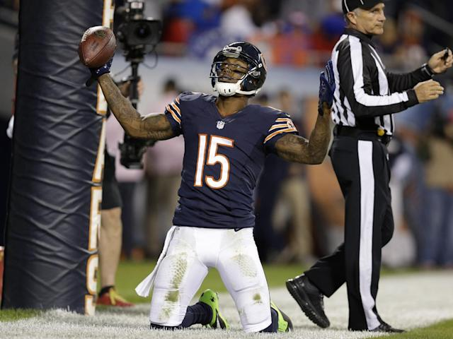 Chicago Bears wide receiver Brandon Marshall (15) celebrates after making a touchdown reception in the first half of an NFL football game against the New York Giants, Thursday, Oct. 10, 2013, in Chicago. (AP Photo/Nam Y. Huh)