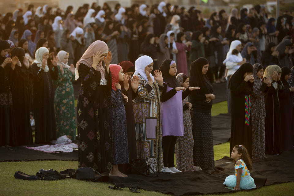 Muslim worshippers offer Eid al-Adha prayer in the mixed Arab Jewish city of Jaffa, near Tel Aviv, Israel, Tuesday, July 20, 2021. The major Muslim holiday, at the end of the hajj pilgrimage to Mecca, is observed around the world by believers and commemorates prophet Abraham's pledge to sacrifice his son as an act of obedience to God. (AP Photo/Oded Balilty)