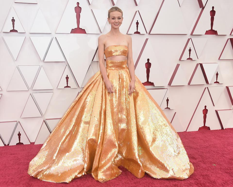 CAREY MULLIGAN in gold two-piece Valentino gown at the oscars 2021
