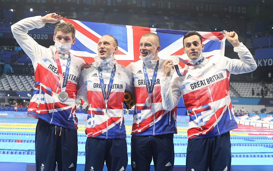 Duncan Scott, Luke Greenbank, Adam Peaty and James Guy pose with their silver medals from the Men's 4x100m Medley Relay on day nine of the Tokyo 2020 Olympic Games at Tokyo Aquatics Centre on August 01, 2021 in Tokyo, Japan. - GETTY IMAGES