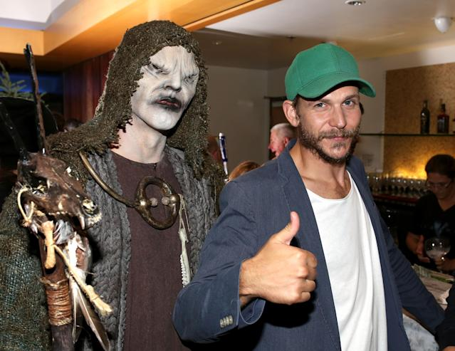 "Gustaf Skarsgard and ""The Seer"" attend History's ""Vikings"" Party at WIRED Cafe in the Omni Hotel during Comic-Con 2013 on July 19, 2013 in San Diego, California."