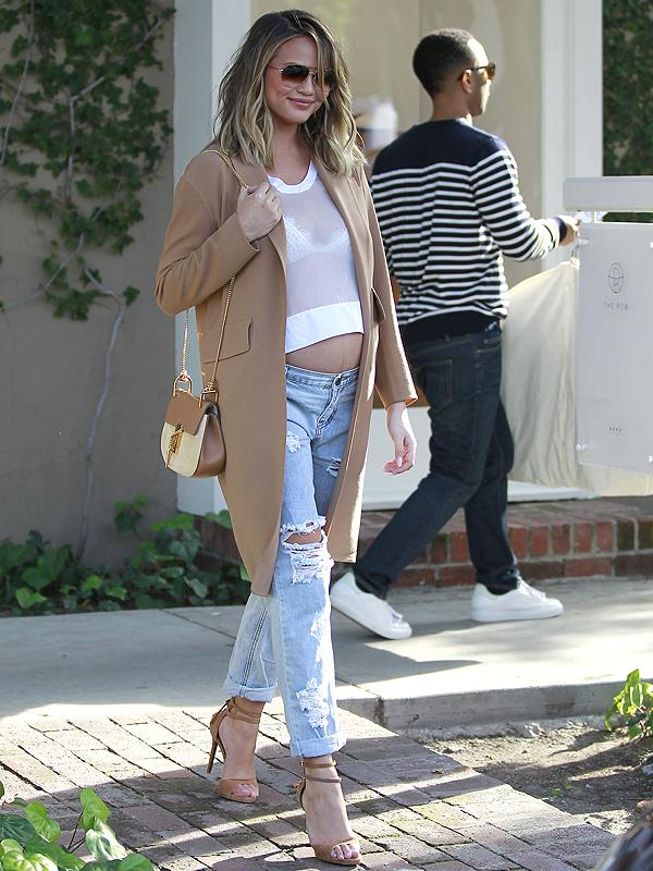 595780df30f06 Chrissy Teigen Flashes Her Bare Baby Bump in a See-Through Crop Top ...