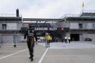 Pato O'Ward, of Mexico, walks back to the garage area during a practice session for the Indianapolis 500 auto race at Indianapolis Motor Speedway, Wednesday, Aug. 12, 2020, in Indianapolis. (AP Photo/Darron Cummings)
