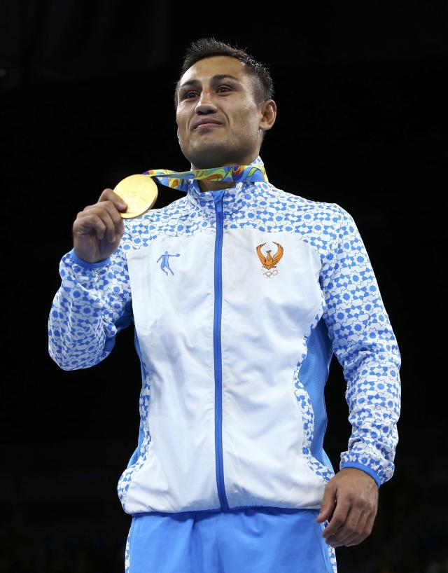 2016 Rio Olympics - Boxing - Victory Ceremony - Men's Light Welter (64kg) Victory Ceremony - Riocentro - Pavilion 6 - Rio de Janeiro, Brazil - 21/08/2016. Gold medallist Fazliddin Gaibnazarov (UZB) of Uzbekistan poses with his medal. REUTERS/Peter Cziborra FOR EDITORIAL USE ONLY. NOT FOR SALE FOR MARKETING OR ADVERTISING CAMPAIGNS.
