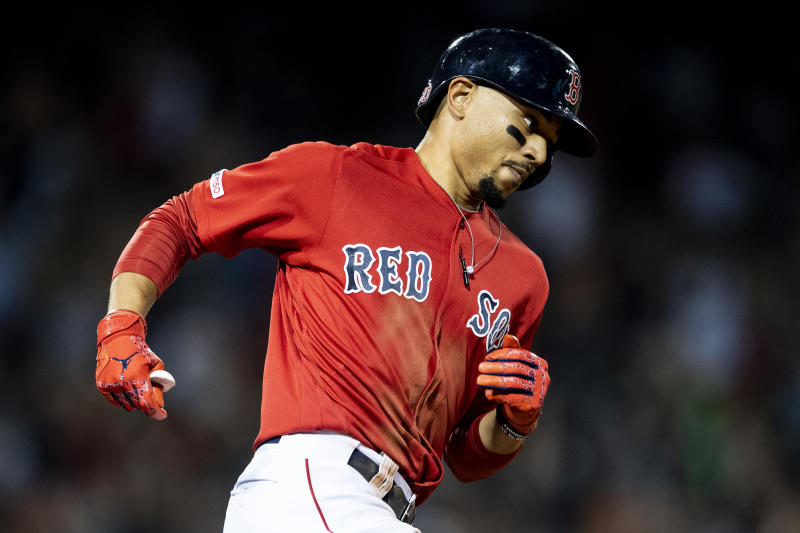 BOSTON, MA - AUGUST 9: Mookie Betts #50 of the Boston Red Sox rounds the bases after hitting a go ahead two run home run during the fifth inning of a game against the Los Angeles Angels of Anaheim on August 9, 2019 at Fenway Park in Boston, Massachusetts. (Photo by Billie Weiss/Boston Red Sox/Getty Images)