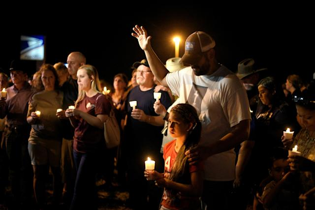 <p>Ramiro and Sofia Martinez attend a candle light vigil after a mass shooting at the First Baptist Church in Sutherland Springs, Texas, Nov. 5, 2017. (Photo: Sergio Flores/Reuters) </p>
