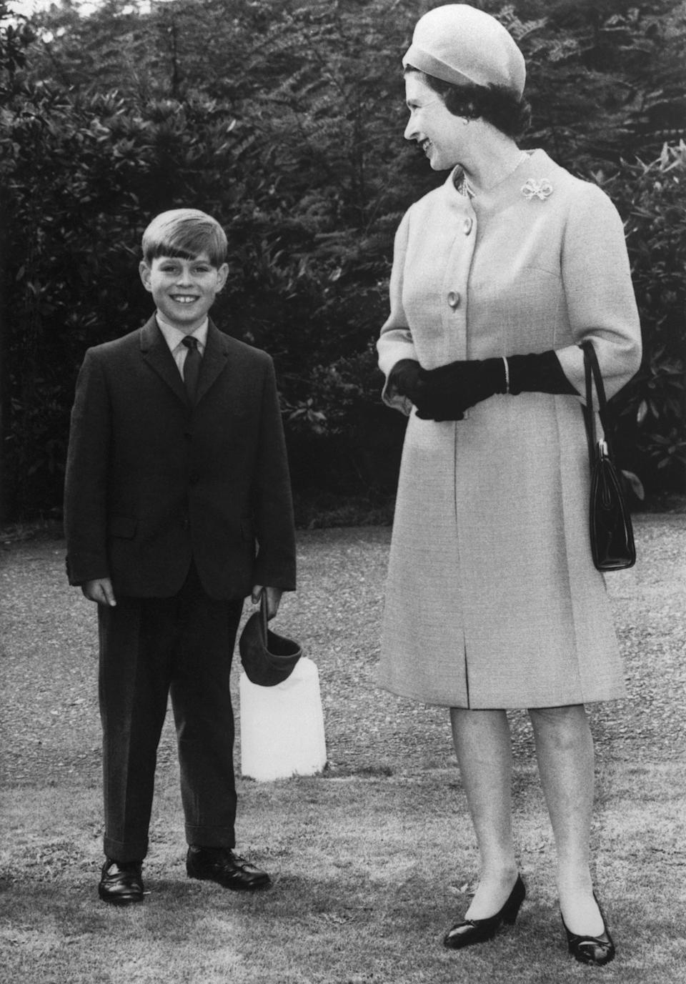 The Queen accompanies Prince Andrew on his first day at Heatherdown Preparatory School in Ascot, England, in 1968. [Photo: Getty]