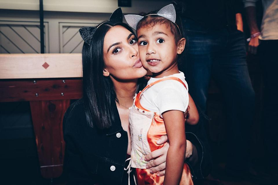 """<p>We have the press to thank for North West's unusual moniker. When Kim was pregnant with her first child, media speculation about what Kimye would call the baby was off the scale with many suggesting the name North as a joke.<br>""""It was a rumour in the press and we'd never really considered it seriously, at all,"""" Kim later explained to GQ. """"But Kanye and I were having lunch about a year ago and Pharrell [Williams] came over to us and said, 'Oh, my God, are you guys really going to call your daughter North? That is the best name.' I said, 'No we're not, that's just a rumour.""""<br>Not long after Anna Wintour, the editor of US Vogue, told the couple she thought it was a genius name. """"Kanye and I looked at one another and just laughed. I guess at that point it sort of stuck.""""<br>North's grandma Kris Jenner also revealed a further meaning behind the name telling The View: """"The way [Kim] explained it to me was that North means highest power and she says that North is their highest point together."""" <em>[Photo: Getty]</em> </p>"""