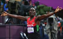 LONDON, ENGLAND - AUGUST 09: David Lekuta Rudisha of Kenya celebrates after winning gold and setting a new world record of 1.40.91 in the Men's 800m Final on Day 13 of the London 2012 Olympic Games at Olympic Stadium on August 9, 2012 in London, England. (Photo by Alexander Hassenstein/Getty Images)