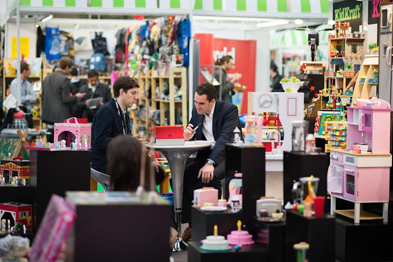 Trade representatives speak during the Toy Fair 2015 in central London on January 20, 2015. Toy Fair, the only dedicated toy, game and hobby exhibition in Britain, features over 260 companies competing for business. AFP PHOTO / LEON NEAL (Photo credit should read LEON NEAL/AFP/Getty Images)