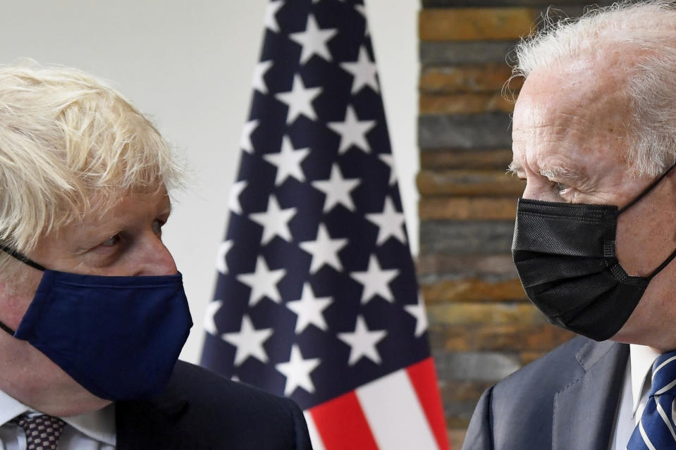U.S. President Joe Biden, right, talks with Britain's Prime Minister Boris Johnson, during their meeting ahead of the G7 summit in Cornwall, Britain, Thursday June 10, 2021. (Toby Melville/Pool Photo via AP)