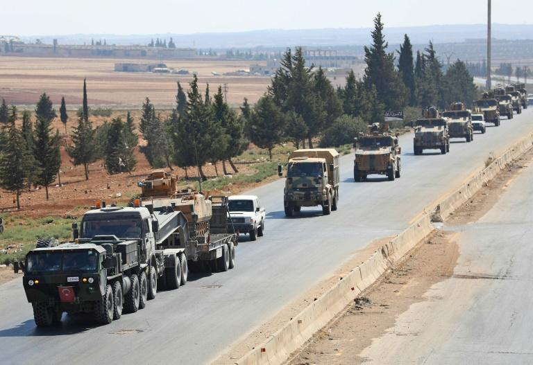Turkish forces are seen in a convoy near the Idlib province town of Saraqib on August 29, 2018 as Ankara seeks to use its influence with the jihadists of the Hayat Tahrir al-Sham (HTS) group to avert a major government offensive against them